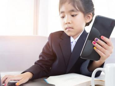 Young Asian Girl In Business Suit Holding Calculator And Working On Laptop