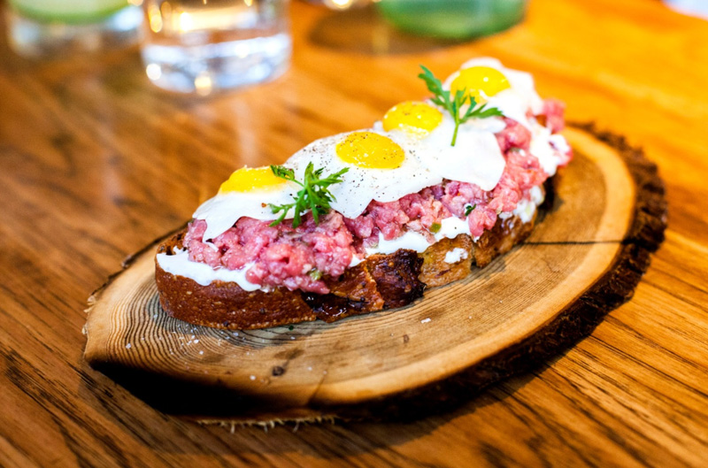 Steak Tartar On Bread Placed on Wooden Plate