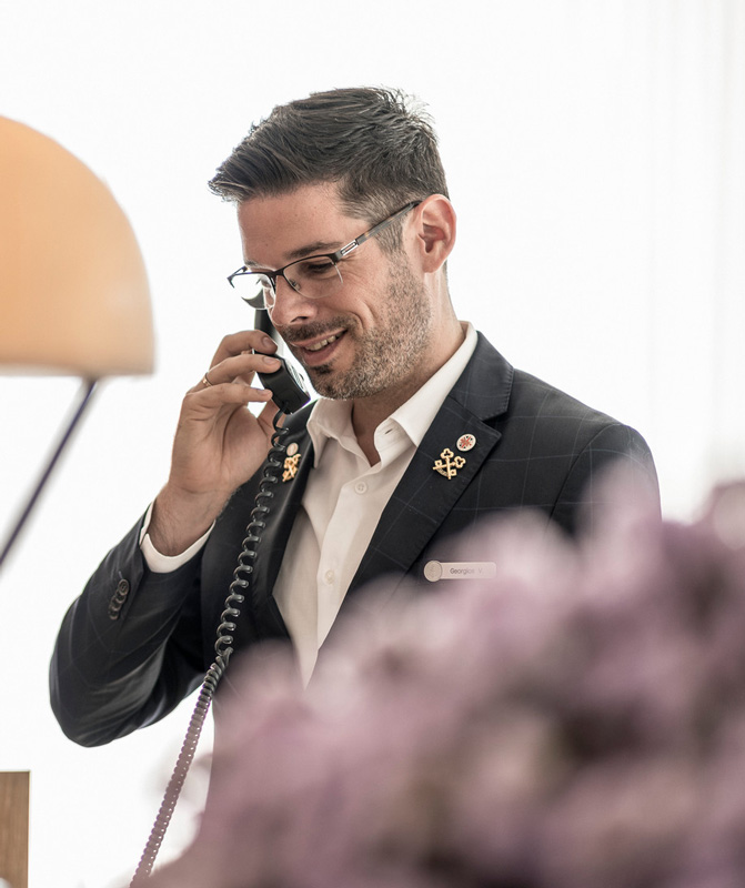 George Vournazos Speaking On Telephone At Front Desk Of Four Seasons Astir Palace Hotel Athens Greece