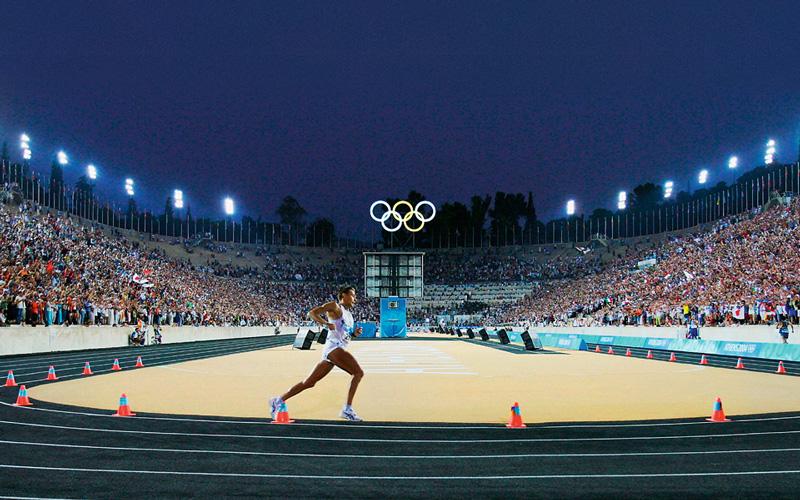 Olympics Runner On Track In Panathenaic Stadium Athens Greece