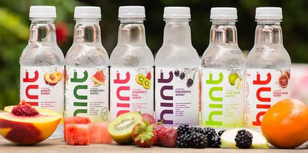 Line Different Flavoured Hint Water Bottles On Table