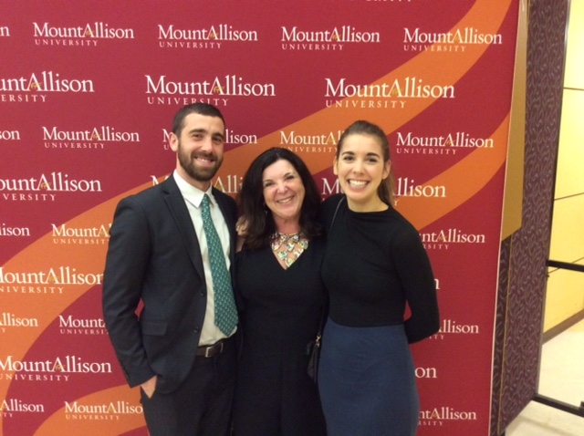 Vianne Timmons With Her 2 Children Posing For Photo With Mount Allison University Photo Backdrop